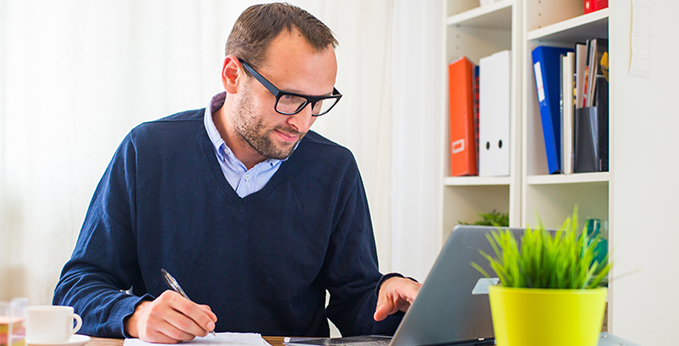 Man Working Remotely from Home Office