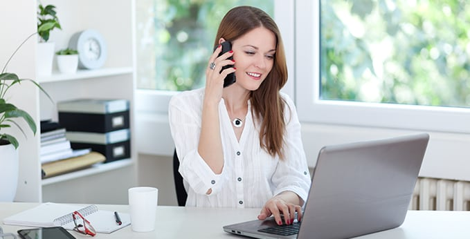 Remote Employee Taking a Business Call from Home