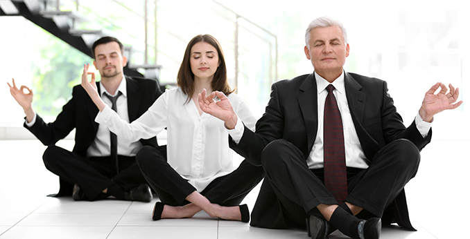 Coworkers Meditating at Work