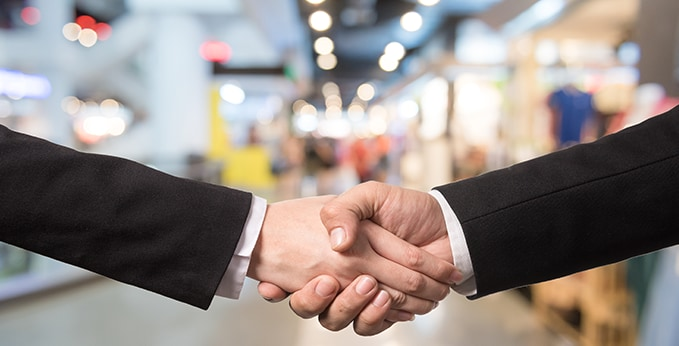 Tradeshow Attendees Shaking Hands