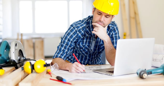 Construction Worker Using Construction Management Software