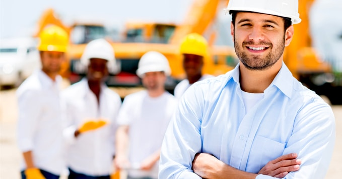 Group of Construction Workers Standing on Worksite