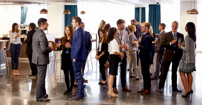 Group of People Mingling at Networking Event