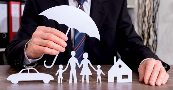 Insurer with Paper Cutouts of Insurance Coverage