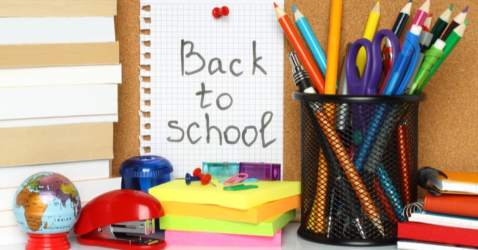 Back to School Note with School Supplies on Desk