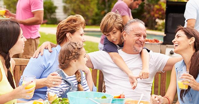 People Enjoying a Family Reunion BBQ