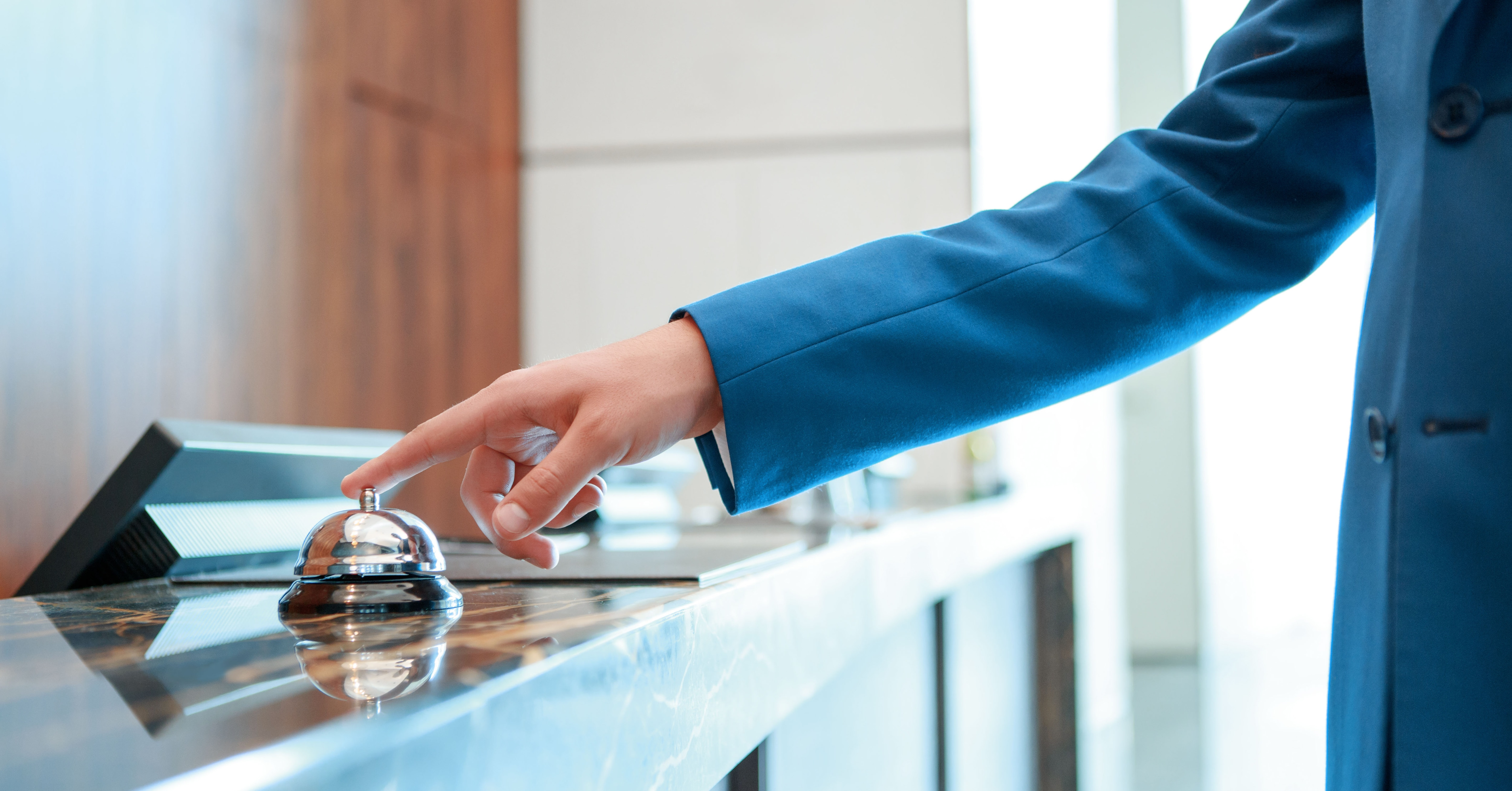 Man Checking in to Hotel Front Desk