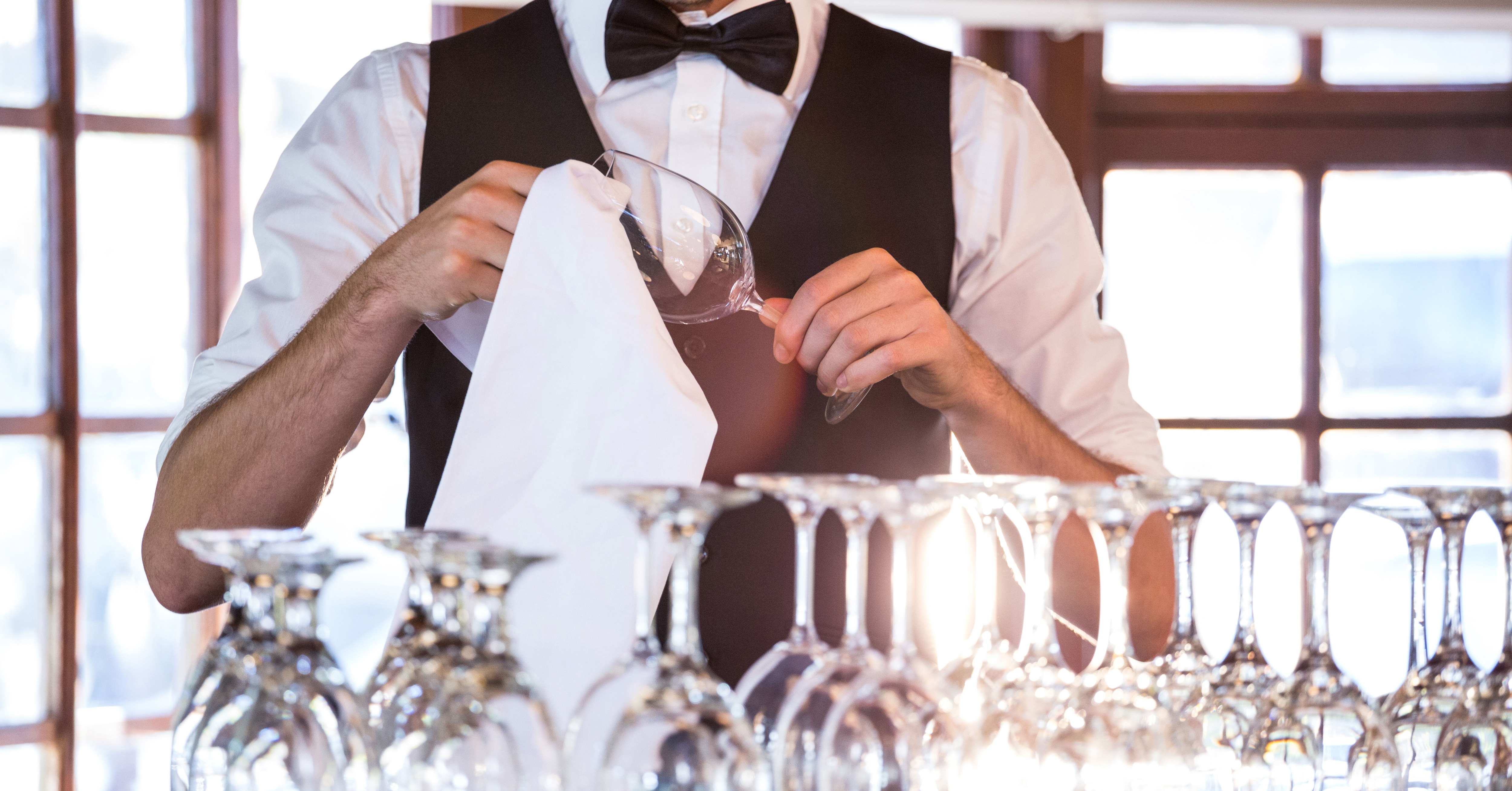 Restaurant Bartender Drying Wine Glasses