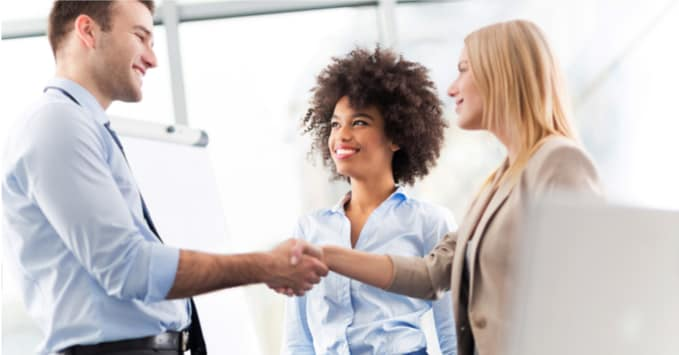 Man Shaking Hands with Trade Show Attendees