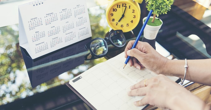 Person Using Calendar to Plan End of Year